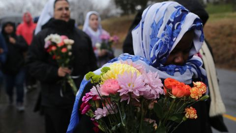 Members of Sisters of Christian Charity go to lay flowers in front of the Sandy Hook Elementary School on December 16 in Newtown.