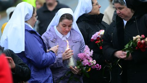 Nuns pay their respects at a makeshift shrine to the victims on December 16.