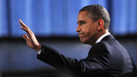 U.S. President Barack Obama waves as he arrives at the memorial service.