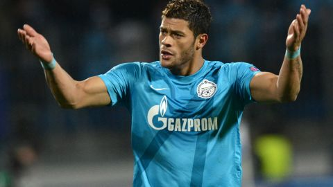 """Zenit St. Petersburg's Brazilian striker Hulk has recently said racism happens at """"almost every game"""" in the Russian league. Hulk had been named in the team of draw assistants for Saturday's event, which also included the likes of Brazilian great Ronaldo, Uruguay's Diego Forlan, Fabio Cannavaro of Italy and Cameroon's Samuel Eto'o, but FIFA said Friday due to his club commitments the Zenit star had been replaced by former Russia captain Alexey Smertin."""