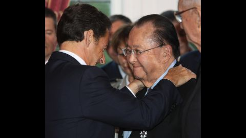 French President Nicolas Sarkozy, left, embraces Inouye after awarding him the Legion d'honneur in Washington on November 6, 2007. Sarkozy decorated seven U.S .World War II veterans at the event.