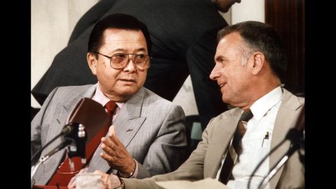 Inouye, left, was chairman of the Senate committee that held hearings on the Iran-Contra affair. Here, he talks with House committee Chairman Lee Hamilton on July 13, 1987.