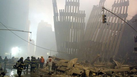 Firefighters make their way through the rubble of the World Trade Center on September 11, 2001. (file photo)