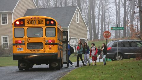 Children in Newtown, Connecticut, return to school on December 18, 2012, four days after the shooting at Sandy Hook Elementary School.