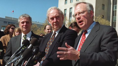 Ex-Whitewater independent counsel Kenneth Starr, right, speaks to reporters with Bork, center, and Mike Pettit, president of ProComp, in 2001 outside the U.S. Federal Courthouse in Washington. The court was hearing an appeal in a Microsoft antitrust case.