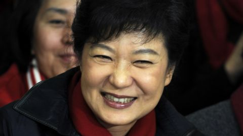 South Korean President-elect Park Geun-Hye, of the Ruling Saenuri Party celebrates with her party members during their applause after she is declared the winner of the presidential elections on December 19, 2012 in Seoul, South Korea. Park, daughter of former president Park Chung-Hee, becomes the first female president of South Korea. (Photo by Song Kyung-Seok-pool/Getty Images)