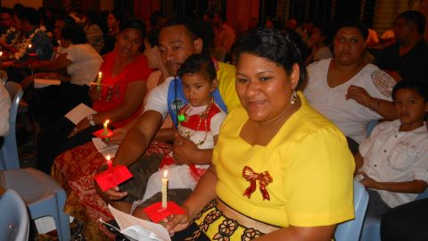 """<a href=""""http://ireport.cnn.com/people/RomaniaScene"""">Natalie Montanaro</a> captured this moment of a happy family attending a carol performance in the Pacific island of Tonga. """"Although we are showered with tropical sunshine, shaded by coconut palms and quenched by the cool blue of the South Pacific, it's already 'beginning to look (and feel!) a lot like Christmas,"""" she said."""