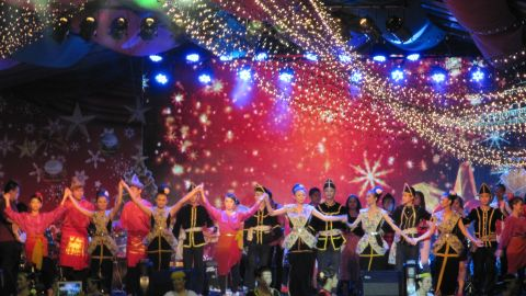 """This Christmas, <a href=""""http://ireport.cnn.com/people/WanderRock"""">Peter Harrits</a> traded his native winter white Wisconsin for the hot and humid Borneo, Malaysia, where he is currently on assignment. He took this photo of the annual Christmas carnival in Kota Kinabalu. """"To me, the carnival is a perfect example of the diversity that makes Malaysia such a fascinating place to explore,"""" he said. <br /><br />""""It is kind of surreal to be standing there sweating in the tropical heat of Borneo surrounded by Christmas lights and carols and statues of wise men and camels as a blizzard of faux-snow swirls past the palm trees around you,"""" he added."""