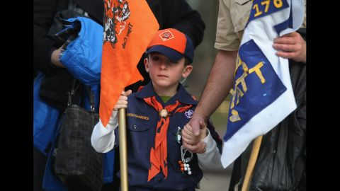 Mourners, including Boy Scout and Tiger Scout members,  depart the funeral on December 20, 2012. Wheeler was a member of Tiger Scout Den 6.
