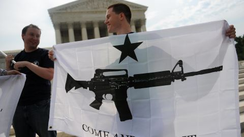 """Gun rights activists celebrate a 2008 U.S. Supreme Court decision on whether the Constitution's Second Amendment right to """"keep and bear arms"""" is fundamentally an individual or collective right. IReporter INGunowner's reasons for owning his AK-47 include his """"fascination with the Second Amendment, which I view as a backstop protector of freedom."""""""