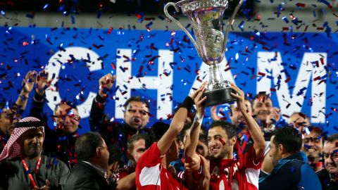 Syrian players raise the trophy as they celebrate their victory over Iraq in the final of the 7th West Asia Football Federation (WAFF) championship in Kuwait City, on December 20, 2012. AFP