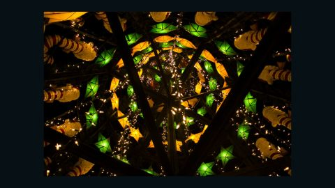 """<a href=""""http://ireport.cnn.com/people/Keemalexis"""">Kim Tinambacan</a> captured this cool image of a Christmas tree entirely made from recycled materials -- such as plastic, Styrofoam and foils -- in Santa Rosa, the Philippines. """"I decided to take this kind of photo because it really symbolizes the true meaning of Christmas ingenuity here in the Philippines,"""" she said."""