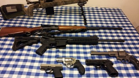 """Military style rifles are important to many gun collectors. iReporter Nathan Lee's firearms include a black AR-15 military-style rifle -- seen here second from the top. IReporter Hrothgar-01 said AR-15s are as much a part of the nation's history """"as the muskets carried by pioneers"""" and """"the rifles toted by doughboys in the trenches."""""""