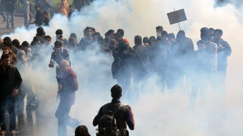 Demonstrators react from tear gas fired by police on December 22. New Delhi alone reported 572 rapes last year and more than 600 in 2012.