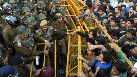 Demonstrators push against a police barricade on December 22.