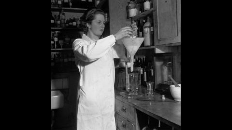 Conservative Party candidate Margaret Roberts, the youngest candidate for any party in the 1950 general election, works in a laboratory where she was a research chemist.