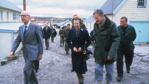 Thatcher and her husband, Denis, left, visit a school in the Falkland Islands in 1983.