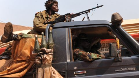 Central African Republic soldiers patrol a street of Bangui last year