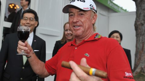 Jimenez celebrates with a glass of red wine and a cigar after claiming victory at the 2012 Hong Kong Open. He would return a year later to successfully defend his title -- his fourth success at the tournament.