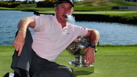 Jimenez, puffing that trademark cigar, celebrates after winning the French Open in July 2010.