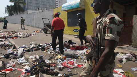 Clothing and various items are scattered on the pavement at the scene of a stampede in Abidjan, on January 1, 2013.