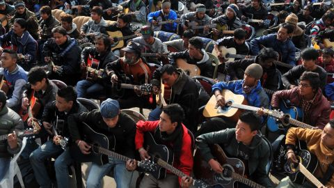"""About 600 guitarists play John Lennon's """"Imagine"""" in a tribute to the rape victim in Darjeeling on January 3."""