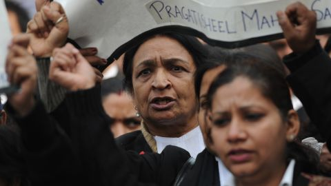Indian lawyers shout during a protest at the entrance to Saket District Court in New Delhi on Thursday, January 3.