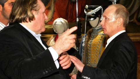 (File) Photo taken on December 11, 2010, shows Vladimir Putin (R) speaking with French actor Gerard Depardieu in St. Petersburg.