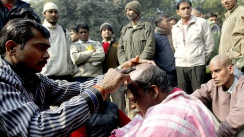 An Indian activist gets his head shaven in protest against the Dehli gang-rape in New Delhi on Friday, January 4. A gang of men is accused of repeatedly raping a 23-year-old student on a moving bus in New Delhi. Police formally charged the five suspects with rape, kidnapping and murder after the woman died.