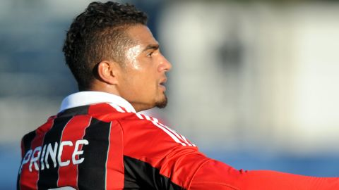 Ac Milan's Ghanaian defender Prince Kevin Boateng reacts during the friendly football match between Pro Patria and Ac Milan in Busto Arsizio on January 3, 2013. Boateng stormed off the pitch after racist chants from a group of fans on Thursday, forcing a friendly away game against fourth-tier club Pro Patria to be suspended. 'Shame that these things still happen,' the 25-year-old German-born Ghanaian player said on his Twitter account after the match was stopped in the 26th minute when he led his team off the pitch. Boateng picked up the ball, kicked it towards the stands and walked off the pitch in Pro Patria's home town of Busto Arsizio near Milan. AFP PHOTO / ALBERTO LINGRIA (Photo credit should read )