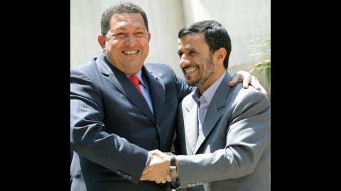 """Chavez embraces Iranian President Mahmoud Ahmadinejad, right, in Tehran, Iran, on July 1, 2007.  The two presidents have enjoyed a close relationship and Chavez has referred to Ahmadinejad as his """"ideological brother."""""""