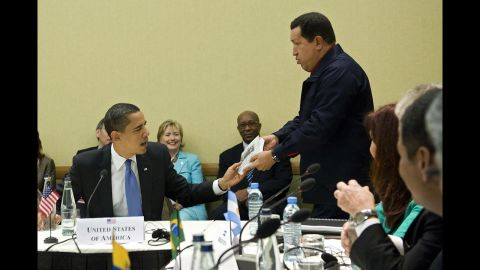 """Chavez, right, gives a copy of the book, """"The Open Veins of Latin America"""" by Eduardo Galeano to President Barack Obama during a multilateral meeting at the Summit of the Americas in Port of Spain, Trinidad, on April 18, 2009."""