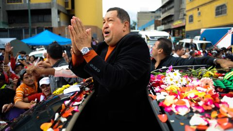 Chavez acknowledges supporters on the streets of Caracas while on his way to the airport to travel to Cuba for ongoing cancer treatment on February 24, 2012.