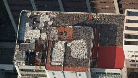 """Several thousand shark fins laid out to dry were found on the rooftop of a building housing seafood suppliers in Kennedy Town in central Hong Kong. Photographer Gary Stokes from the <a href=""""http://www.seashepherd.org"""" target=""""_blank"""" target=""""_blank"""">Sea Shepherd Conservation Society</a> received a tip from an unnamed person earlier this year and took these pictures."""