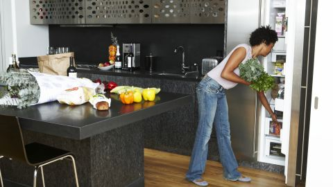 """<strong>1. Give your fridge a makeover.</strong> Let's start in the kitchen. The first thing to do is toss or give away any """"trigger foods,"""" Rost says. (Yes, that means the raw cookie dough you find yourself eating at 2 a.m.) Next, move fruits, vegetables and lean protein to a shelf at eye level. Put less healthy foods farther down or in the back where they're difficult to spot. Finished? Tackle your pantry with the same tips in mind."""