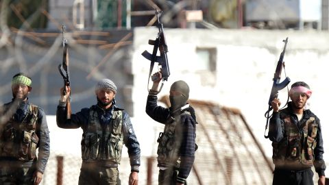 Turkish border town of Ceylanpinar shows Syrian opposition fighters celebrating on the strategic Syrian border town of Ras al-Ain, on November 15, 2012.