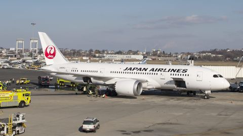 Firefighters investigate the interior of a Japan Airlines 787 Dreamliner after reports of smoke in the aircraft at Boston Logan International Airport in Boston, Massachusetts, on Monday, January 7.