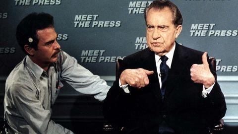 """Former President Nixon is wired for a microphone on April 9, 1988, before the taping of the NBC television show """"Meet the Press."""" It was his first appearance on the show since 1968."""