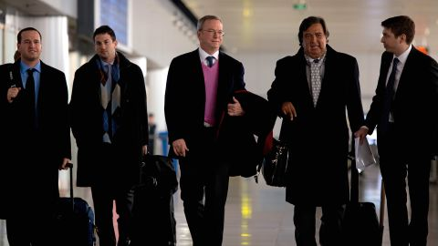 Former New Mexico governor Bill Richardson (2nd R) and Google chairman Eric Schmidt (C) arrive at Beijing airport from North Korea on January 10, 2013. Richardson and Schmidt met with reporters following their visit to secretive North Korea calling for greater Internet freedom for the welfare of its people. AFP PHOTO / Ed Jones (Photo credit should read Ed Jones/AFP/Getty Images)