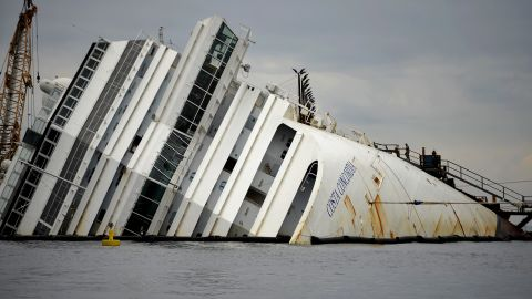 The Costa Concordia cruise ship lays aground near the port on January 9, 2013 on the Italian island of Giglio. A year on from the Costa Concordia tragedy in which 32 people lost their lives, the giant cruise ship still lies keeled over on an Italian island and its captain Francesco Schettino has become a global figure of mockery.  AFP PHOTO / FILIPPO MONTEFORTE        (Photo credit should read FILIPPO MONTEFORTE/AFP/Getty Images)