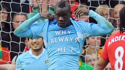 """Balotelli became a hit with City's fans, as much for off-field antics as his goalscoring. His stock with the supporters was never higher than in October 2011, when he scored twice in City's 6-1 thumping of neighbors Manchester United at Old Trafford. After scoring the first goal in City's victory, he revealed a t-shirt stating """"Why always me?"""" -- instantly creating one of the most iconic images of the Premier League era. City went to beat United to the English title on goal difference with a dramatic last-gasp victory over Queens Park Rangers on the final day of the season."""