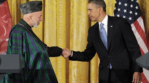 US President Barack Obama (R) shakes hands with his Afghan counterpart Hamid Karzai after a joint press conference in the East Room at the White House in Washington, DC, on January 11, 2013. Obama and Karzai said that US forces would hand the lead in the fight against the Taliban to Afghan forces in the next few months.