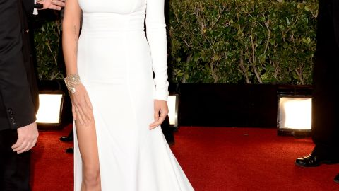 Heidi Klum hit the red carpet with one shoulder and one leg exposed.