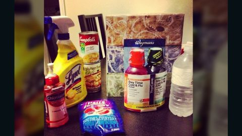 """<a href=""""http://ireport.cnn.com/docs/DOC-909180"""">Rachel James</a>, a nurse in Bethlehem, Philadelphia, says she not only has the flu, but a terribly painful sore throat as well. Her flu survival kit is made up of variety of medications, disinfectants, water and soups, and she says frozen Slurpees are soothing her throat."""