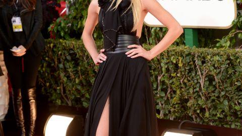 Rosie Huntington-Whiteley let one leg peek out of her black Yves Saint Laurent gown.