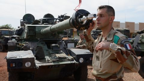French army Legionnaire from the Licorne force based in Abidjan (Ivory Coast) checks the canon of a Sagai tank on January 15, 2013 at the 101 military airbase near Bamako, before leaving as part of France's 'Serval' operation in the Islamists occupyed northern Mali.