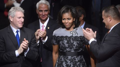 At the final 2012 presidential debate in Boca Raton, Florida, Obama donned the same Thom Browne fog-gray dress with black lace overlay that she had worn at the Democratic National Convention, reworked this time with a black belt and a stone brooch, Taylor noted.