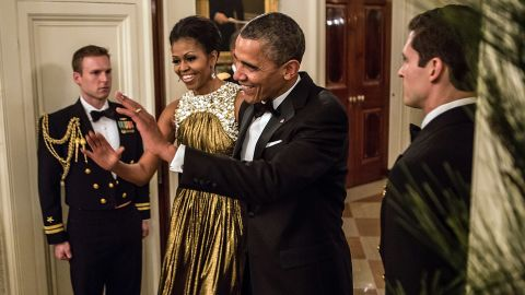 Obama greeted the audience at the Kennedy Center Honors in December 2012 in a striking gold lamé gown by Michael Kors, fashion consultant Mikki Taylor noted.