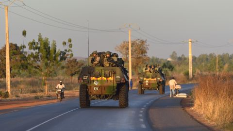 French army soldiers stand on armoured vehicles as they leave Bamako and start their deployment to the north of Mali as part of the Serval operation on Tuesday, January 15.