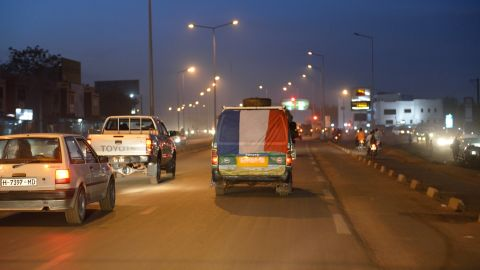 A French flag is hung on a van in Bamako as French troops start a deployment in the north of Mali on Wednesday.